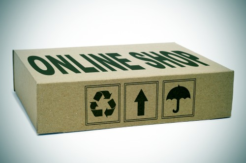 a cardboard box with the text online shop written in it